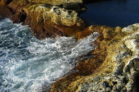 coast line: lake on the coast with ocean waves