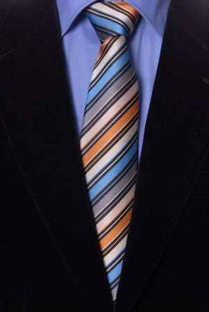 detail of a Business man Suit with colored tie Stock Photo