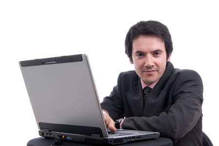 Handsome young business man working with laptop photo