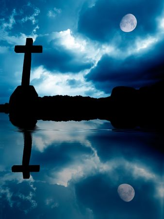 cross silhouette with full moon and the water Stock Photo