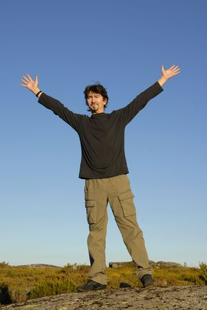 young man with arms wide open and the sky as background Stock Photo - 2190517