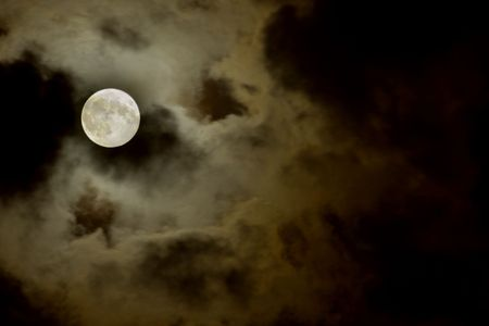 big moon over the clouds in a dark night Stock Photo - 2206727