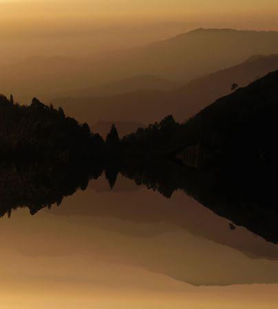 mountain layers sunset, with lake water reflection photo
