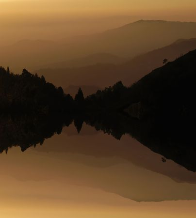 mountain layers sunset, with lake water reflection photo