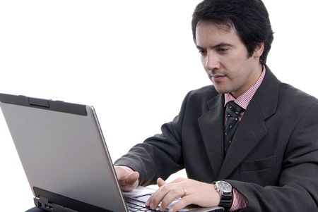 Handsome young business man working with laptop Stock Photo - 2241088