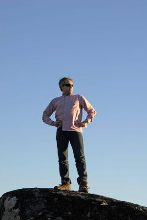 man on a rock and the sky as background Stock Photo - 2241012