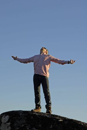 young man with arms wide open and the sky as background Stock Photo - 2250309