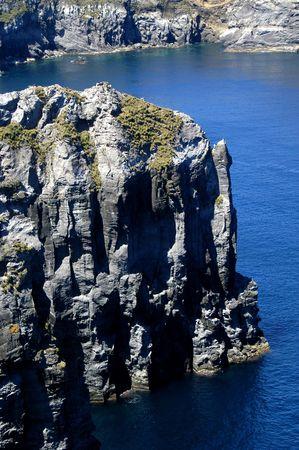 coast line: calm blue waters of azores coastal rocks Stock Photo