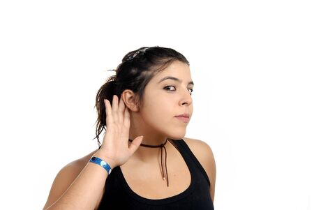 earing: young woman with open hand, earing something Stock Photo