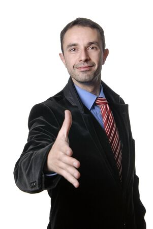 young man in suit offering to shake the hand photo