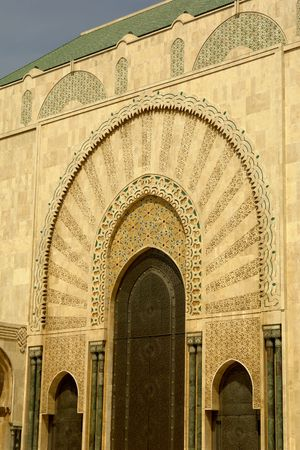 ancient golden arabic building detail in Morocco photo