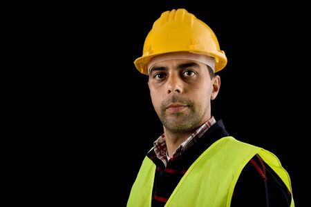 young worker portrait in a black background