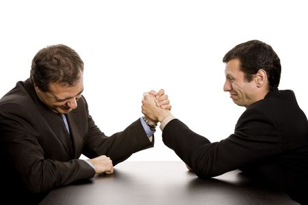 two business men wrestling isolated on white background photo