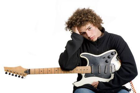 young man musician with guitar, studio picture photo