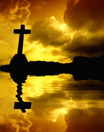 cross detail in silhouette and the clouds in the sky photo