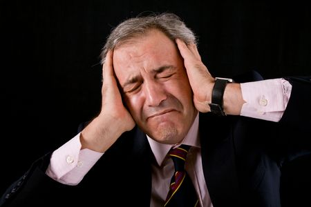 worried businessman: sad mature business man on a black background Stock Photo