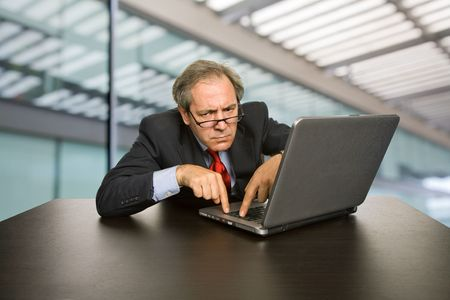 mature business man working with his laptop Stock Photo