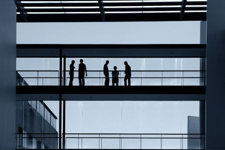 workers inside the modern building in silhouette                                photo