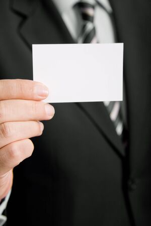 Hand of businessman offering business card on white background Stock Photo - 3609994