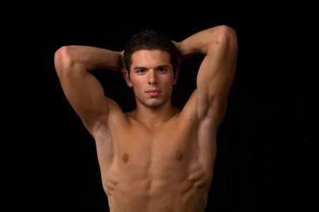 young sensual man on a black backgroung Stock Photo - 3618521