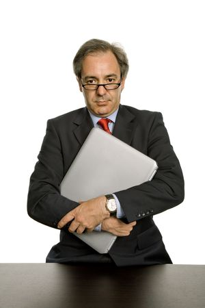 bore: mature business man with his laptop, isolated on white