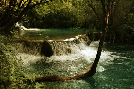 small river waterfall on Plitvice lakes in Croatia photo