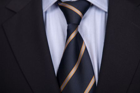 silk wool: detail of a business man suit with blue tie