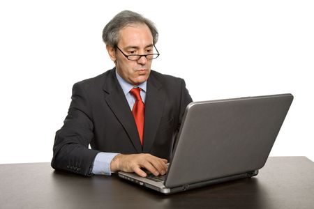 bore: mature business man working with his laptop Stock Photo