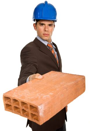 young business man with a brick, on white photo