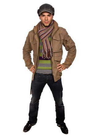 warm color: studio picture of a young man dressed for winter Stock Photo