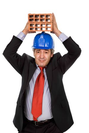 mature business man with two bricks, on white Stock Photo - 3845315