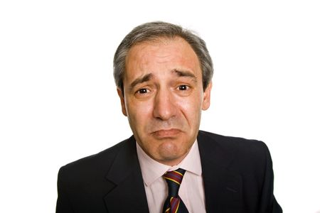 man crying: sad mature business man on a black background Stock Photo