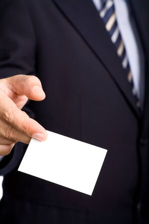 detail of a hand of business man offering businesscard photo