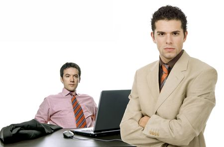 two young business man working with is laptop photo
