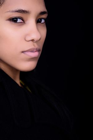 young beautiful woman close up portrait, on black background Stock Photo