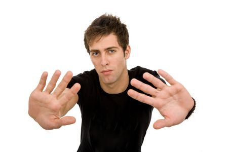 young casual man making stop with his hands photo