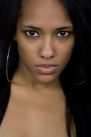 young beautiful woman closeup portrait, studio shot photo