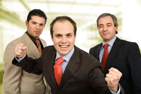 three happy business men with open arms photo