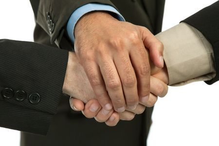 close up of three men hands together in a deal, studio picture