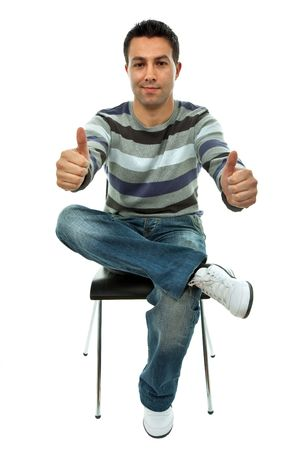 young casual man on a chair going thumbs up, isolated on white Stock Photo - 4591456