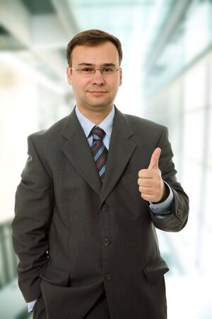 business man going thumb up at the office Stock Photo - 4736000