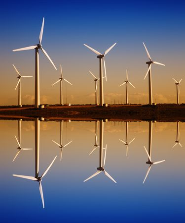 white wind turbines with digital water reflection