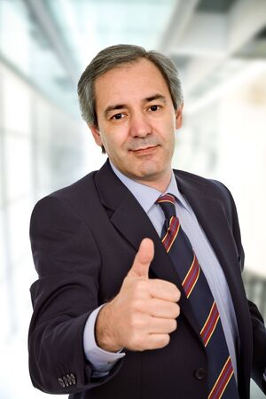 business man going thumb up at the office Stock Photo - 4946160