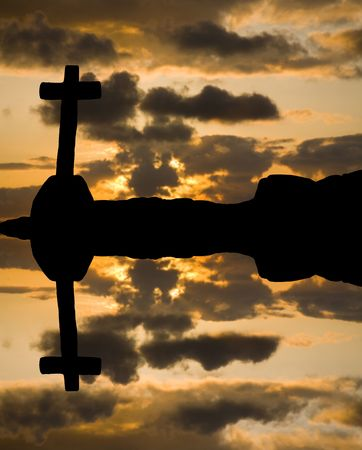 cross silhouette and the clouds at sunset Stock Photo - 5088625