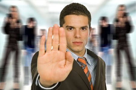 business man with open hand making stop photo
