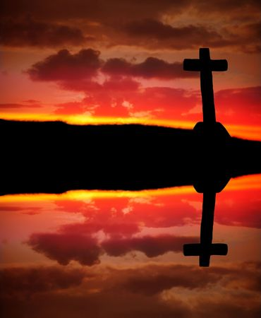cross silhouette and the clouds at sunset photo