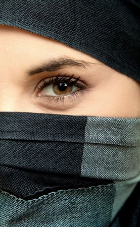 woman eye detail, dressed with a veil photo