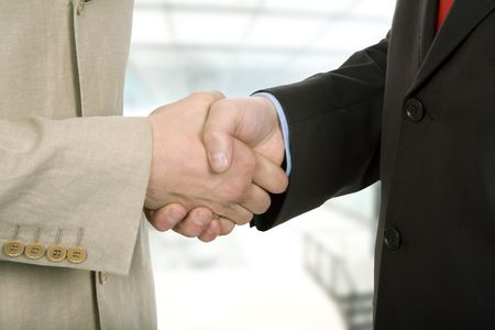 deal making: Business team hand shake at the office