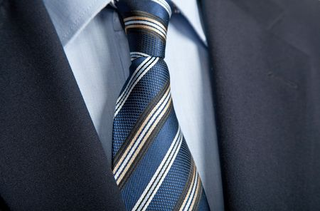 formal attire: detail of a business man suit with blue tie