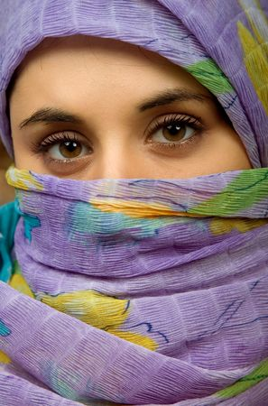 women face stare: young woman with a veil close up portrait studio picture